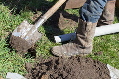 High boots with a shovel Stock Images
