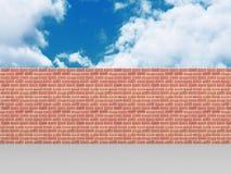 High brick wall on blue cloudy sky background Stock Photos