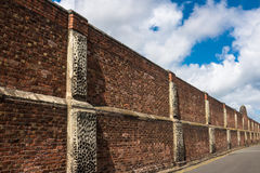 High Brick Wall Security Barrier Royalty Free Stock Photo