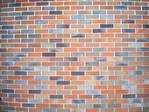 High brick wall with small, flat bricks stock image