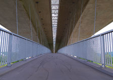 A high bridge. A high bridge with bicycle path under it Stock Photo