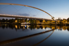 The High Bridge of Maastricht reflected in the Meuse river. Stock Photos