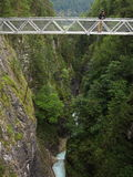 High bridge over gorge with man Stock Image