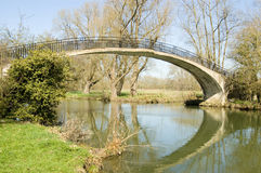 High Bridge over River Cherwell, Oxford. The High Bridge, also known as Rainbow Bridge, over the River Cherwell at Oxford University Parks, Oxford Royalty Free Stock Images