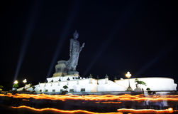 High Buddha statue at twilight in Visakha Puja day Stock Image