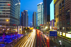 High building with blue sky background at night. Down town Shanghai Stock Image