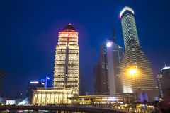 High building with blue sky background at night. Down town Shanghai Stock Photo