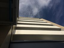 High building with blue sky stock photography