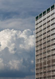 High building and bulk cumulus Stock Photography