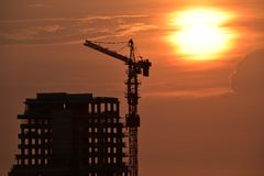 High building constructio with sillhouette Stock Images