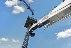 High building crane against the blue sky. Background Royalty Free Stock Images
