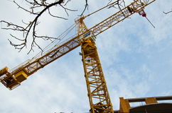 High building crane at the construction site Royalty Free Stock Photos