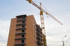 High building crane at the construction site Stock Photos