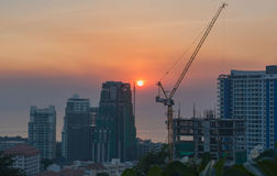 High building and crane under construction .sunset for background Stock Photos