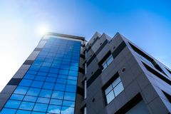High building with mirroring windows stock photo