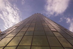 High building shot from below with golden yellow and the windows Royalty Free Stock Photos