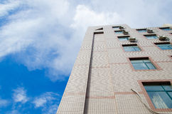 High building under blue sky. In summer Stock Photography