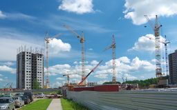 High building under construction with cranes Royalty Free Stock Images