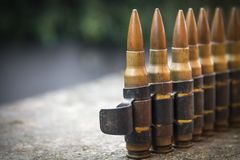 High Caliber Bullets on Belt. Closeup Royalty Free Stock Photo