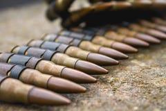 High Caliber Bullets on Belt. On Rock Royalty Free Stock Image