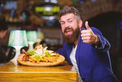High calorie snack. Relax after hard day. Delicious food. Businessman formal suit sit at restaurant. Man received meal. With fried potato fish sticks meat. He stock photos