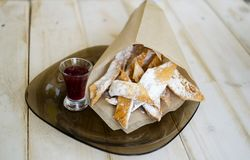 High calories fried dessert with raspberry jam and powdered su Royalty Free Stock Photos