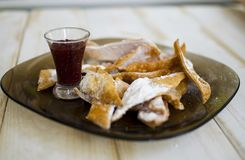 High calories fried dessert with raspberry jam and powdered su Royalty Free Stock Image