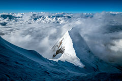 High camp surrounded by mountains and clouds Royalty Free Stock Images