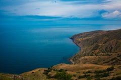 High cape near seashore. Marine landscape. Place for meditation stock photos