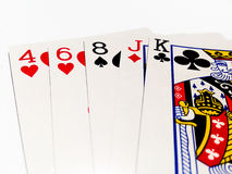High Card in Poker Game with White Background. A playing card is a piece of specially prepared heavy paper, thin cardboard, plastic-coated paper, cotton-paper Stock Photo