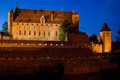 High Castle of Malbork Castle in Poland at Night. High Castle of the Malbork Castle illuminated at night in Poland, medieval fortress built by the Teutonic Stock Photos