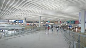 An Airport Broad Walkway Traveler royalty free stock photography