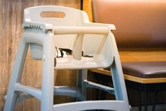 High chair seat for sit eating position for kids in fast food.use baby chair seat for safe cute child in cafe breakfast.high chair. Seat have guard for protect royalty free stock photos