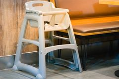 High chair seat for sit eating position for kids in fast food.use baby chair seat for safe cute child in cafe breakfast.high chair. Seat have guard for protect stock photos