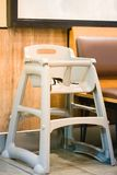 High chair seat for sit eating position for kids in fast food.use baby chair seat for safe cute child in cafe breakfast.high chair. Seat have guard for protect royalty free stock images