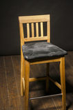 High chair from wood and black cover Royalty Free Stock Photos