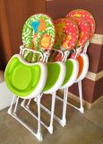 High chairs stacked up in a restaurant. 4 high chairs folded up in a hotel royalty free stock images