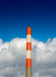 High Chimney With Clouds. High Red and White Chimney High Chimney With Clouds royalty free stock photography