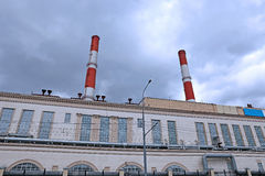 High chimneys over the building of CHP Royalty Free Stock Images