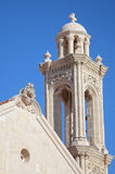 High church bell tower opposite blue sky Stock Image