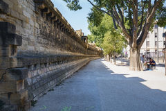 The high city wall of Avignon. Avignon, France, September 9, 2015: The historic center of Avignon in France  is surrounded by a high city wall Stock Photos