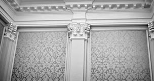 High class wall. Majestic wall covered in fabric, with columns, capitals, crown molding Royalty Free Stock Photos