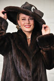 High class woman dressed in luxurious fur coat Stock Images