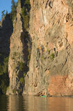 High cliff. At shore of Mazinaw Lake in sunset light Stock Image