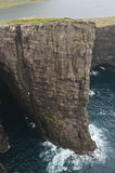 High cliff in Faroe Islands. A beautiful and high cliff with a lake on the top Stock Photos
