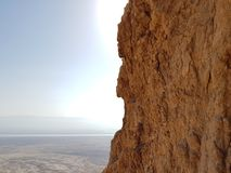 High cliff at the Masada National Park in Israel. With the sun halation Royalty Free Stock Photo
