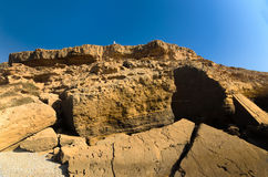 High cliff in Morocco with seldom person on its edge. High cliff near the ocean in Morocco with seldom person on its edge Stock Image