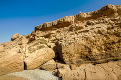 High cliff in Morocco with seldom person on its edge royalty free stock photos