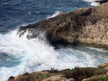 High cliff on the sea with waves Royalty Free Stock Images