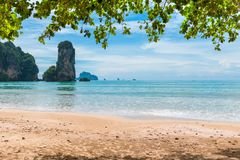 High cliff in the turquoise waters of the Andaman Sea Krabi Stock Photography